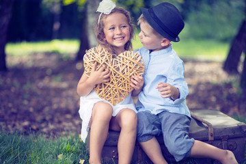 Portrait of cute couple of small children