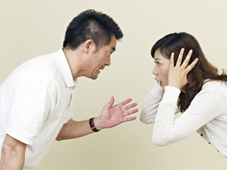 young asian couple shouting at each other