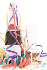 Champagne bottle and flutes on a party setting.