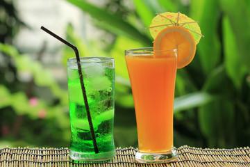 Green fruit soda and orange juice