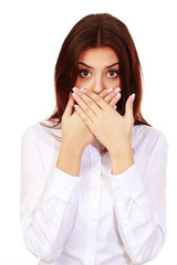 surprised woman with hands over her mouth isolated on white