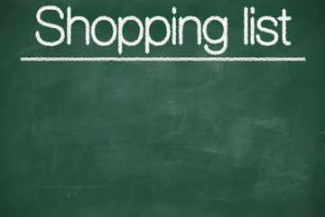 Shopping list written with white chalk
