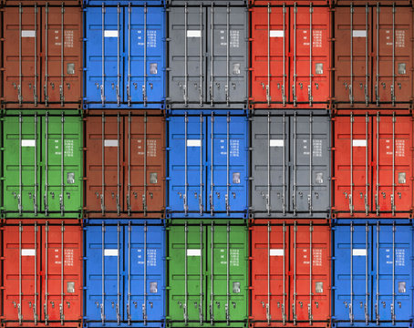 Bright red metal freight shipping container isolated on white