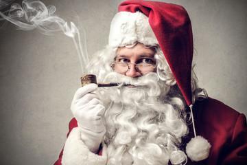 Santa smokes pipe