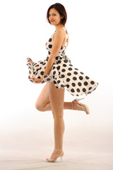 Pretty pin-up girl dancing isolated white background