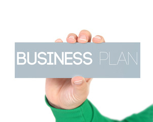 woman holding a label with business plan