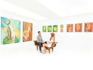 young couple talking about artworks