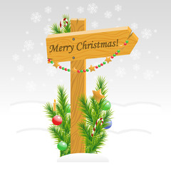 Wooden arrow with Christmas toys with text