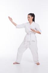 Beautiful woman in kimono show martial art exercise on white