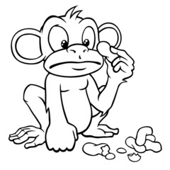 Black and white cartoon monkey looking at some peanuts.