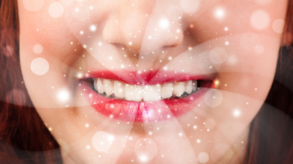 Pretty woman lips blowing abstract white lights