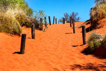 Orange sandy path going uphill in Australian outback