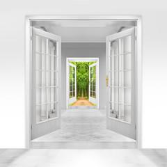 Opened door to  green garden. Environmental business metaphor.