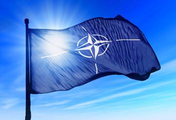 NATO flag waving over the sky