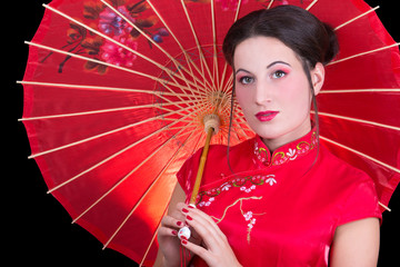 portrait of beautiful geisha in red japanese dress with umbrella