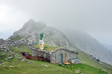 Wall Mural - House on mountain range with fog