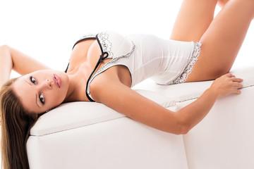 Elegant woman in lingerie on sofa