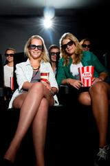 Friends watching 3D movie at cinema