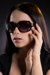 Woman in sunglasses. Attractive young woman in sunglasses lookin