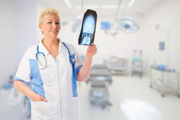Mature doctor with x-ray