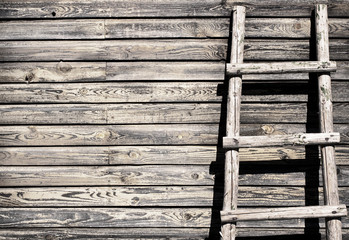 old grungy wooden wall background with ladder