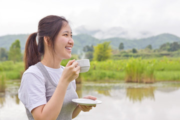 Young woman drinking coffee at mountain view