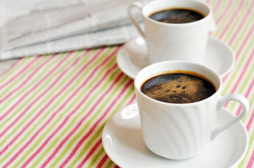Two cups of morning coffee