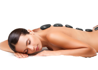 Wall Mural - Stone Massage. Beautiful Woman Getting Spa Hot Stones Massage. S