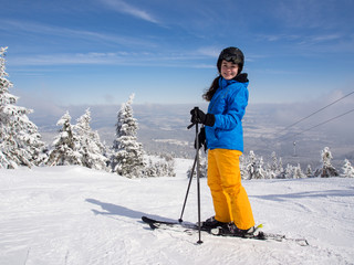 Teenage girl skiing