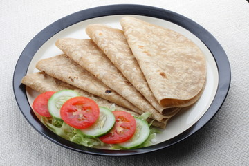 Homemade chapati  with fresh vegetables.