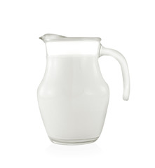Glass jug of fresh milk on white background