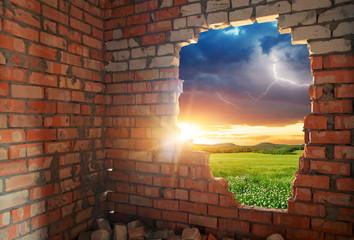 Broken bricks wal and landscape