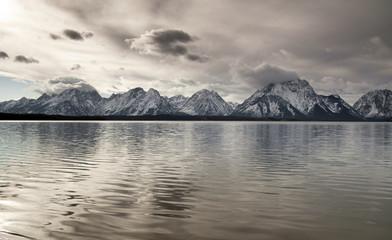 Wall Mural - Lake Reflection Cloud Cover Jagged Peaks Grand Teton Wyoming