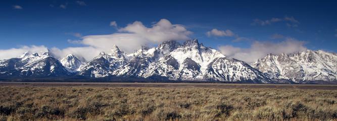 Wall Mural - Jagged Peaks Grand Teton Wyoming Bright Sun Snow Clouds