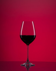 Wine glass with red background