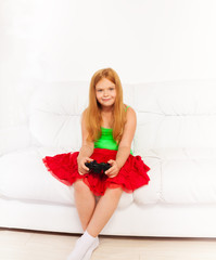 Girl on the sofa playing video games