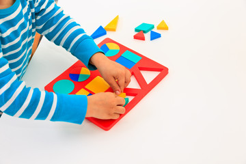 child learning shapes, early education