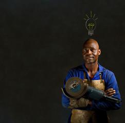 African industrial worker with light bulb blackboard