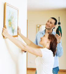Happy  couple choosing place for picture in frame