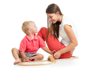 kid boy and his mom play with block toy