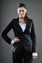 Successful businesswoman with hand on hip