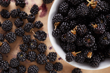 Bowl of blackberries on table