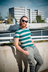 stylish hipster model with long red hair and beard lifestyle