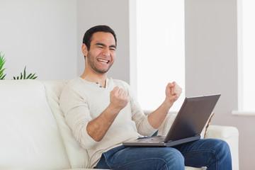 Successful casual man cheering