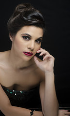 Elegant beautiful young woman in dress