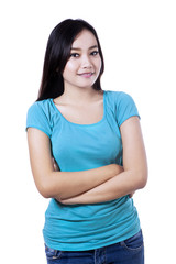 Smiling woman with arms folded - isolated