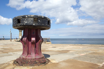 Old wooden capstan on Whitby pier