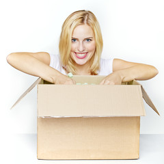 Woman unpacks something out of a box