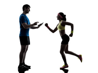 Wall Mural - woman exercising jogging man coach using digital tablet
