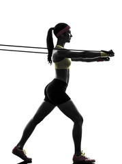 Wall Mural - woman exercising fitness workout resistance bands silhouette